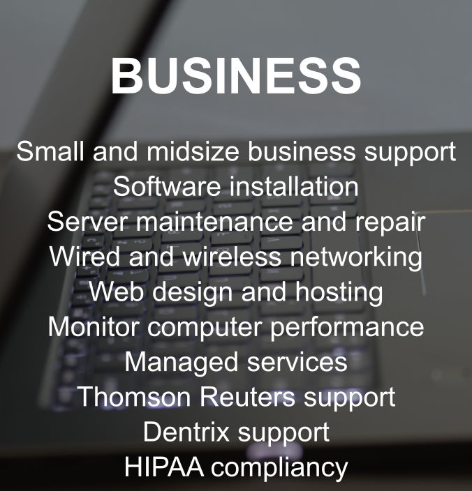 An open laptop with glowing keyboard listing business support options and managed services
